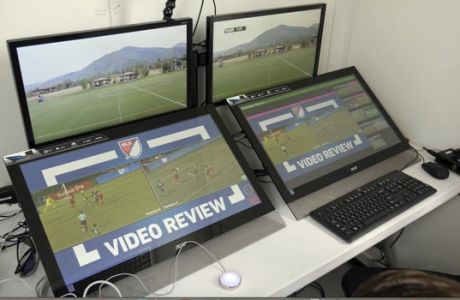 FILE - In this July 11, 2017, still image from video, review screens are displayed before a video replay soccer scrimmage in Park City, Utah. Major League Soccers implementation of video replay got use its first weekend, as fans and other leagues around the world were watching to see how it would go. (AP Photo/Rick Bowmer, File)