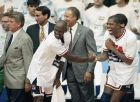 "FILE - In this Aug. 8, 1992, file photo, USA's Earvin ""Magic"" Johnson, right, and Michael Jordan shake hands near the end of their 117-85 win over Croatia in the gold medal game in men's basketball at the Summer Olympics in Barcelona. Head coach Chuck Daly, left, and his assistant coaches Mike Krzyzewski, second left, and Lenny Wilkens, center, look on  It's not an urban legend: The Dream Team really did lose a scrimmage to a group of college stars as the future Hall of Famers prepared for the 1992 Olympics. Footage of that game is among the new behind-the-scenes material in the 20-year anniversary documentary that premieres on NBA TV on Wednesday.(AP Photo/John Gaps)"