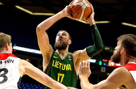 Lithuania's Jonas Valanciunas, centre, goes to the basket between Germany's Patrick Heckmann, left, and Danilo Barthel during their Eurobasket European Basketball Championship Group B match in Tel Aviv, Israel, Wednesday, Sept. 6, 2017. (AP Photo/Ariel Schalit)