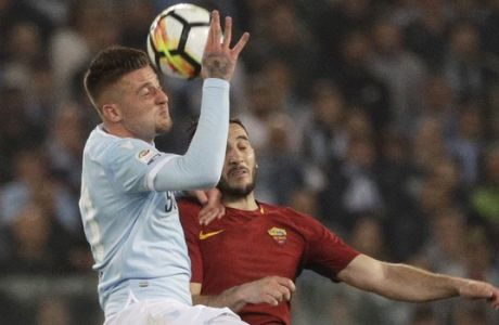 Lazio's Sergej Milinkovic-Savic, left, and Roma's Kostas Manolas vie for the ball during an Italian Serie A soccer match between AS Roma and Lazio, at the Olympic stadium in Rome, Sunday, April 15, 2018. (AP Photo/Gregorio Borgia)