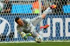 BELO HORIZONTE, BRAZIL - JUNE 28:  Julio Cesar of Brazil saves a penalty kick by Alexis Sanchez of Chile (not pictured) during the 2014 FIFA World Cup Brazil round of 16 match between Brazil and Chile at Estadio Mineirao on June 28, 2014 in Belo Horizonte, Brazil.  (Photo by Ronald Martinez/Getty Images)