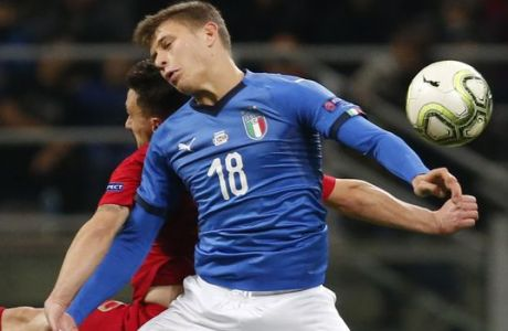 Portugal's Mario Rui, left, and Italy's Nicolo Barella jump for the ball during the UEFA Nations League soccer match between Italy and Portugal at the San Siro Stadium, in Milan, Saturday, Nov. 17, 2018. (AP Photo/Antonio Calanni)