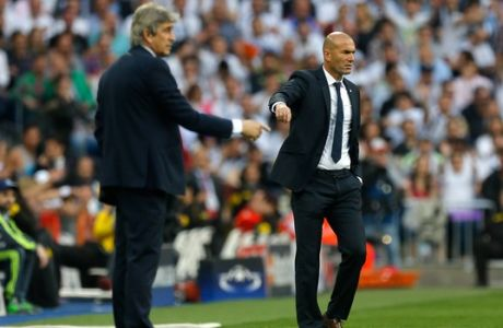 Real Madrid's coach Zinedine Zidane, right, and Manchester City manager Manuel Pellegrini gesture during the Champions League semifinal second leg soccer match between Real Madrid and Manchester City at the Santiago Bernabeu stadium in Madrid, Wednesday May 4, 2016. (AP Photo/Francisco Seco)