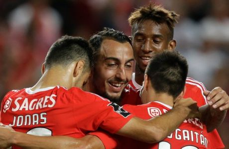 Benficas Mitroglou, second left, celebrates after scoring the opening goal during the Portuguese league soccer match between Estoril and Benfica at Benfica's Luz stadium in Lisbon, Sunday, Aug. 16, 2015. (AP Photo/Armando Franca)