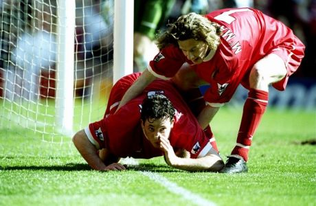 3 Apr 1999:  Robbie Fowler of Liverpool is pulled away by team mate Steve McManaman after mimicking cocaine snorting to celebrate his first goal against Everton in the FA Carling Premiership match at Anfield in Liverpool, England. Liverpool won 3-2. \ Mandatory Credit: Ross Kinnaird /Allsport