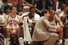 New York Knicks, from left, Kiki Vandeweghe, Patrick Ewing and Mark Jackson, share a laugh with their coach Rick Pitino during the final minutes of their game against the Chicago Bulls in New York, May 12, 1989. (AP Photo)