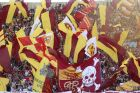 Roma supporters wave scarves and flags prior to the Serie A soccer match between Roma and Lazio, at the Rome Olympic Stadium, Saturday, Sept. 29, 2018. (AP Photo/Andrew Medichini)