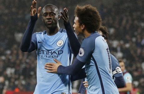 Manchester City's Yaya Toure, left, celebrates scoring a goal with Manchester City's Leroy Sane during the English Premier League soccer match between West Ham and Manchester City at the London stadium, Wednesday, Feb. 1, 2017. (AP Photo/Frank Augstein)
