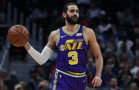 Utah Jazz guard Ricky Rubio passes during the first half of an NBA basketball game against the Detroit Pistons, Saturday, Jan. 5, 2019, in Detroit. (AP Photo/Carlos Osorio)