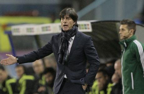 Germany's coach Joachim Low gives instructions, during an international friendly soccer match between Spain and Germany at the Balaidos stadium, in Vigo, Spain, Tuesday Nov. 18, 2014. (AP Photo/Lalo R. Villar)