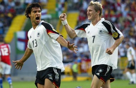 FILE - In this June 23, 2004 file photo Germany's Michael Ballack, left, celebrates with teammate Bastian Schweinsteiger after scoring the opening goal during the Euro 2004 Group D soccer match between Germany and the Czech Republic at the Jose Alvalade Stadium in Lisbon, Portugal. Germany captain Bastian Schweinsteiger said Friday, July 29, 2016 he is quitting the national team. The 31-year-old said in a Twitter statement that hes asked Germany coach not to include him in the line-up in future.  (AP Photo/Thomas Kienzle, file)