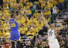 Golden State Warriors forward Kevin Durant (35) shoots as Utah Jazz center Rudy Gobert (27) defends in the second half during Game 3 of the NBA basketball second-round playoff series Saturday, May 6, 2017, in Salt Lake City. Warriors won 102 - 91. (AP Photo/Rick Bowmer)