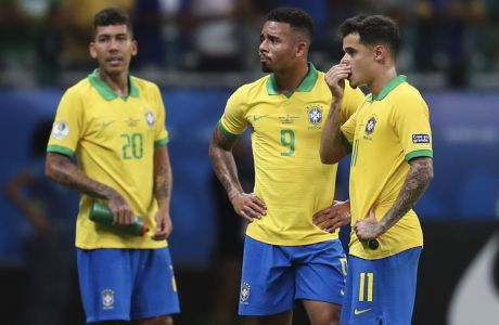Brazil's Gabriel Jesus, center, waits for the referee to decide on the validity of his goal with teammates Roberto Firmino, left, and Philippe Coutinho, right, during a Copa America Group A soccer match at the Arena Fonte Nova in Salvador, Brazil, Tuesday, June 18, 2019. Referee Julio Bascunan, not in picture, annulled Gabriel Jesus' goal due to an offside position. Firmino and Coutinho also had goals disallowed during the match. (AP Photo/Natacha Pisarenko)