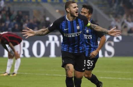 Inter Milan's Mauro Icardi celebrates after scoring during the Serie A soccer match between Inter Milan and AC Milan, at the Milan San Siro Stadium, Italy, Sunday, Oct. 15, 2017. (AP Photo/Antonio Calanni)
