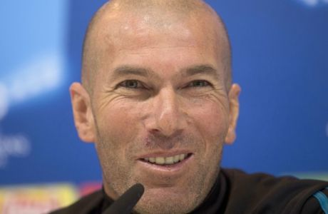 Real Madrid's head coach Zinedine Zidane speaks during a press conference in Madrid, Spain, Tuesday, April 10, 2018. Real Madrid will play Juventus Wednesday in a Champions League quarter-final, 2nd leg soccer match. (AP Photo/Paul White)