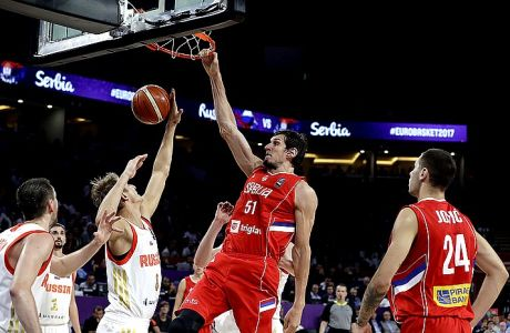 Serbia's Boban Marjanovic, 2nd right, dunks the ball during the Eurobasket European Basketball Championship semifinal match against Russia in Istanbul, Friday, Sept. 15. 2017. (AP Photo/Thanassis Stavrakis)