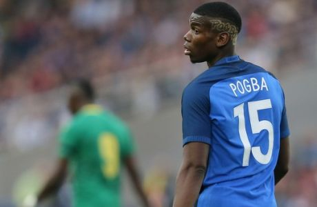 FILE - In this Monday, May 30, 2016 file photo, France's Paul Pogba looks on during a friendly soccer match between France and Cameroon at the La Beaujoire Stadium in Nantes, western France. Manchester United says Paul Pogba has been granted permission to have a medical examination to finalize his transfer to the English club from Juventus. United made the announcement in a one-line statement on Sunday, Aug. 7, 2016 under the hashtag Pogback. (AP Photo/David Vincent, file)