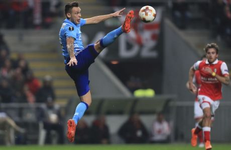 Marseille's Lucas Ocampos stretches to control the ball during the Europa League round of 32 second leg soccer match between SC Braga and Olympique de Marseille at the Municipal stadium in Braga, Portugal, Thursday, Feb. 22, 2018. (AP Photo/Luis Vieira)