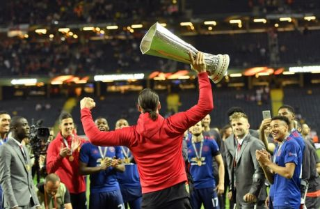 United's Zlatan Ibrahimovic holds the trophy after winning the soccer Europa League final between Ajax Amsterdam and Manchester United at the Friends Arena in Stockholm, Sweden, Wednesday, May 24, 2017. United won 2-0. (AP Photo/Martin Meissner)