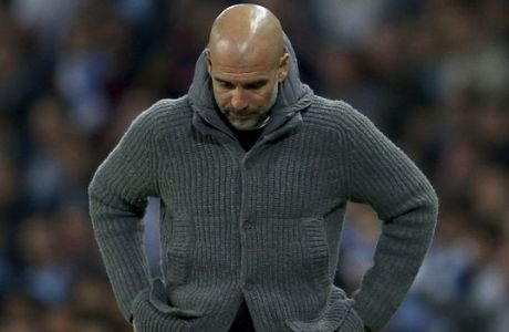 Manchester City coach Pep Guardiola looks down during the Champions League quarterfinal, second leg, soccer match between Manchester City and Tottenham Hotspur at the Etihad Stadium in Manchester, England, Wednesday, April 17, 2019. (AP Photo/Dave Thompson)