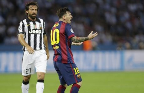 Barcelona's Lionel Messi reacts alongside Juventus' Andrea Pirlo after during the Champions League final soccer match between Juventus Turin and FC Barcelona at the Olympic stadium in Berlin Saturday, June 6, 2015. (AP Photo/Luca Bruno)