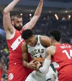 Milwaukee Bucks' Giannis Antetokounmpo tries to drive between Toronto Raptors' Marc Gasol and Danny Green during the first half of Game 5 of the NBA Eastern Conference basketball playoff finals Thursday, May 23, 2019, in Milwaukee. (AP Photo/Morry Gash)