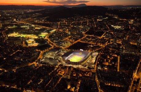 The Camp Nou stadium is illuminated ahead of a soccer match between Barcelona F.C and Eibar in Barcelona, Spain, Tuesday, Sept. 19, 2017. (AP Photo/Emilio Morenatti)