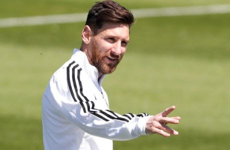 Lionel Messi points during a training session of Argentina on the eve of the group D match against Iceland at the 2018 soccer World Cup in Bronnitsy, Russia, Friday, June 15, 2018. (AP Photo/Ricardo Mazalan)