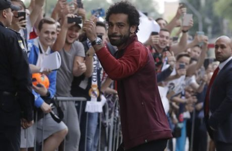 Liverpool's Mohamed Salah as the team arrive at the team's hotel in Kiev, Ukraine, Thursday, May 24, 2018. Liverpool will play Real Madrid in the Champions League final soccer match in Kiev on Saturday May 26. (AP Photo/Sergei Grits)