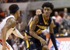 Murray State guard Ja Morant (12) works around Auburn guard Bryce Brown (2) during the first half of an NCAA college basketball game, Saturday, Dec. 22, 2018, in Auburn, Ala. (AP Photo/Vasha Hunt)