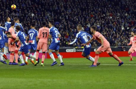 FC Barcelona's Lionel Messi, right, scores during the Spanish La Liga soccer match between Espanyol and FC Barcelona at RCDE stadium in Cornella Llobregat, Spain, Saturday, Dec. 8, 2018. (AP Photo/Joan Monfort)