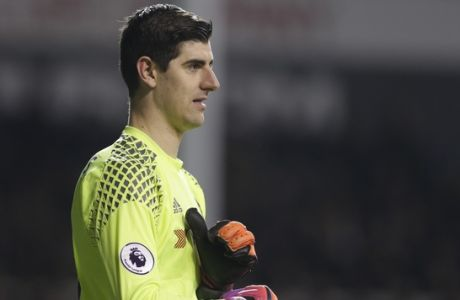 Chelsea goalkeeper Thibaut Courtois  pulls on his gloves during the English Premier League soccer match between Tottenham Hotspur and Chelsea at White Hart Lane stadium in London, Wednesday, Jan.  7,  2017. (AP Photo/Alastair Grant)
