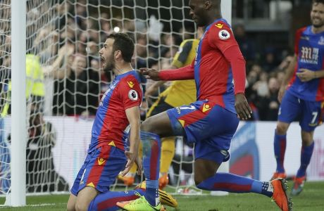 Crystal Palace's Luka Milivojevic, left, celebrates, with Crystal Palace's Christian Benteke, after scoring a penalty during the English Premier League soccer match between Crystal Palace and Arsenal at Selhurst Park in London, Monday April 10, 2017. (AP Photo/Tim Ireland)