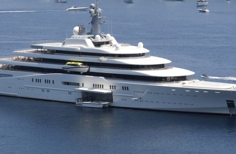 Luxury yacht 'Eclipse' of Russian billionaire Roman Abramovich is seen in the bay of Villefranche sur Mer, near Nice, southeastern France, Saturday, July 6 2013. The yacht is some 160 metres long, is equipped with a missile-detection system, a helicopter pad, a miniature submarine and a luxury spa. (AP Photo/Lionel Cironneau)