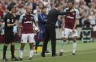 West Ham manager Slaven Bilic, centre, gives instructions to West Ham's Andy Carroll, right, as West Ham's Pablo Zabaleta, left, looks across the pitch during the English Premier League soccer match between West Ham United and Tottenham Hotspur at the London Stadium in London, Saturday Sept. 23, 2017. (AP Photo/Tim Ireland)