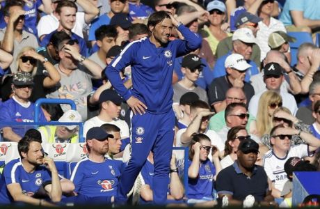 Chelsea coach Antonio Conte stands during the English Premier League soccer match between Chelsea and Liverpool at Stamford Bridge stadium in London, Sunday, May 6, 2018. (AP Photo/Kirsty Wigglesworth)