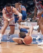 New Jersey Nets' Drazen Petrovic, left, closes in on Cleveland Cavaliers' Danny Ferry as Petrovic dives at Meadowlands Arena in East Rutherford, N.J., April 28, 1992. (AP Photo/Alex Brandon)