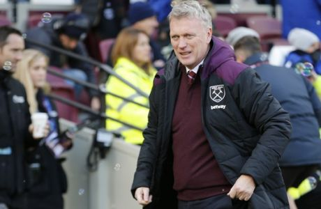 West Ham United manager David Moyes walks before the English Premier League soccer match between West Ham United and Chelsea at the London stadium in London, Saturday, Dec. 9, 2017. (AP Photo/Alastair Grant)