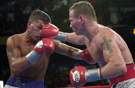 Arturo Gatti, left, takes a right to the face from Micky Ward during their junior welterweight bout Saturday, May 18, 2002, in Uncasville, Conn. Ward won the fight. (AP Photo/Steve Miller)