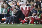 Arsenal manager Arsene Wenger, center, looks dejected during the English Premier League soccer match between Arsenal and Everton at The Emirates stadium in London, Sunday May 21, 2017. (AP Photo/Tim Ireland)