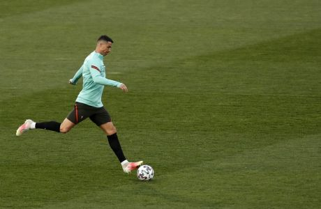 Portugal's Cristiano Ronaldo kicks the ball during a training session prior to the World Cup 2022 group A qualifying soccer match between Serbia and Portugal at the Rajko Mitic stadium in Belgrade, Serbia, Friday, March 26, 2021. Serbia will play against Portugal on Saturday evening. (AP Photo/Darko Vojinovic)