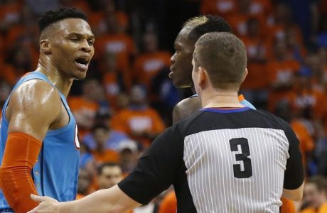 Oklahoma City Thunder guard Russell Westbrook, center, argues with official Nick Buchert (3) as teammate Raymond Felton, left, pulls him away during the second half of Game 3 of the team's NBA basketball first-round playoff series against the Portland Trail Blazers on Friday, April 19, 2019, in Oklahoma City. (AP Photo/Sue Ogrocki)