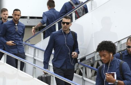 Juventus goalkeeper Gianluigi Buffon, center, arrives with his teammates in Cardiff, Wales, Friday June 2, 2017. Real Madrid will play Juventus in the final of the Champions League soccer match in Cardiff on Saturday. (UEFA Pool via AP)