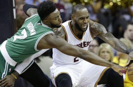 Boston Celtics' Jaylen Brown (7) defends against Cleveland Cavaliers' LeBron James (23) during the first half of Game 3 of the NBA basketball Eastern Conference finals, Sunday, May 21, 2017, in Cleveland. (AP Photo/Tony Dejak)