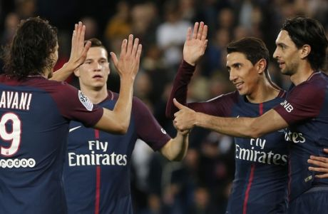 PSG players with Edinson Cavani, left, and Julian Draxler, second left, Javier Pastore, right, celebrate Angel Di Maria, second right, who scored his team's fifth goal during the French League One soccer match between Paris Saint Germain and Monaco at the Parc des Princes stadium in Paris, Sunday, April 15, 2018. (AP Photo/Thibault Camus)