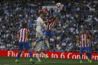 Real Madrid's Cristiano Ronaldo, top left, goes for a header with Atletico Madrid's Diego Godin, top right, during the La Liga soccer match between Real Madrid and Atletico Madrid at the Santiago Bernabeu stadium in Madrid, Saturday, April 8, 2017. The match ended in a 1-1 draw. (AP Photo/Francisco Seco)