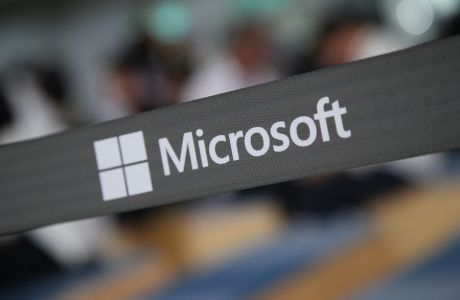 epa06785816 Microsoft logo is pictured during the Computex 2018 in Taipei, Taiwan, 05 June 2018. The 2018 Computex highlights are AI, IoT, 5G, and Blockchain.  EPA/RITCHIE B. TONGO