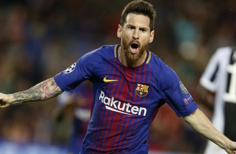 Barcelona's Lionel Messi celebrates scoring his side's first goal during a Champions League group D soccer match between FC Barcelona and Juventus at the Camp Nou stadium in Barcelona, Spain, Tuesday, Sept. 12, 2017. (AP Photo/Francisco Seco)