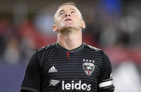 D.C. United forward Wayne Rooney (9) stands on the field during the first half of an MLS playoff soccer match against the Columbus Crew SC, Thursday, Nov. 1, 2018, in Washington. (AP Photo/Nick Wass)