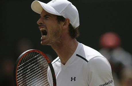 Britain's Andy Murray celebrates after winning a point against Sam Querrey of the United States during their Men's Singles Quarterfinal Match on day nine at the Wimbledon Tennis Championships in London Wednesday, July 12, 2017. (AP Photo/Tim Ireland)